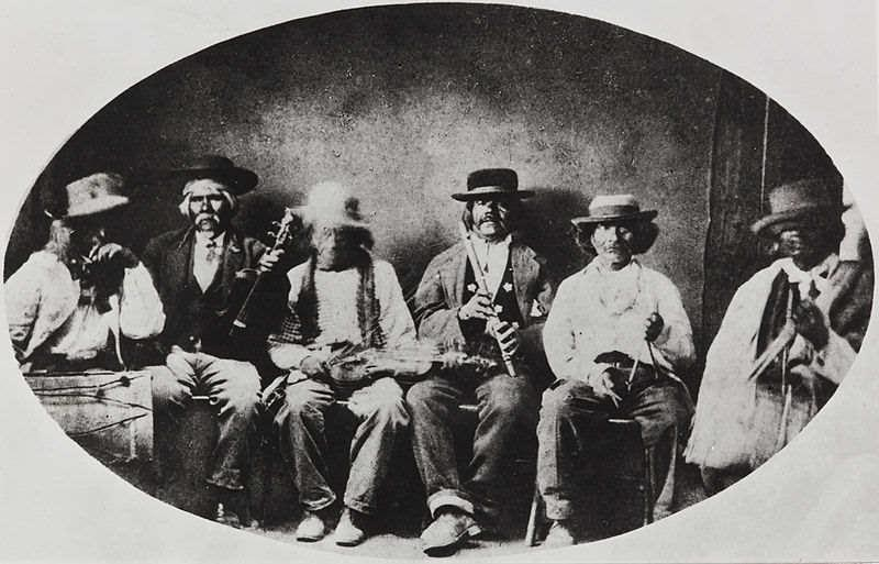 A photograph showing the elders listening to the womans story